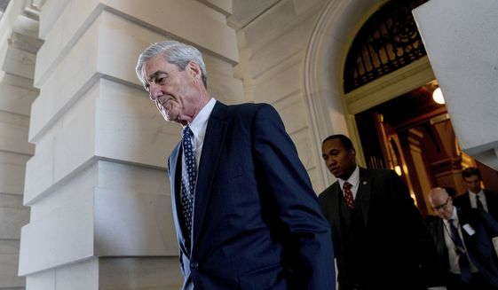 In this June 21, 2017, file photo, former FBI Director Robert Mueller, the special counsel probing Russian interference in the 2016 election, departs Capitol Hill following a closed-door meeting in Washington. (AP Photo/Andrew Harnik, File)