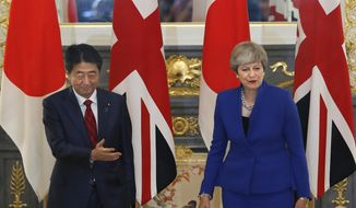 British Prime Minister Theresa May, right, greets by her Japanese counterpart Shinzo Abe, right, prior to a meeting at Akasaka Palace state guesthouse in Tokyo, Thursday, Aug. 31, 2017. (AP Photo/Shizuo Kambayashi, Pool)