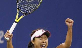 Kurumi Nara, of Japan, reacts after upsetting the No. 8 seed, Svetlana Kuznetsova, of Russia, 6-3, 3-6, 6-3 at the U.S. Open tennis tournament in New York, Thursday, Aug. 31, 2017. (AP Photo/Kathy Willens)