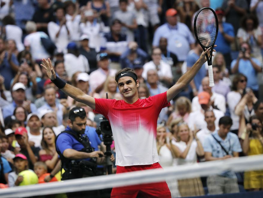 Roger Federer, of Switzerland, reacts after defeating Mikhail Youzhny, of Russia, during the second round of the U.S. Open tennis tournament, Thursday, Aug. 31, 2017, in New York. (AP Photo/Andres Kudacki)