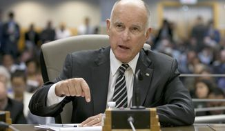 In this July 13, 2017, file photo, California Gov. Jerry Brown testifies during a hearing of the Senate Environmental Quality committee in Sacramento, Calif. Brown is traveling to Russia next week to discuss collaborating with Pacific nations on climate change at an economic forum hosted by the Russian government. (AP Photo/Rich Pedroncelli, File)