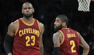 FILE - In this March 19, 2017, file photo, Cleveland Cavaliers' LeBron James, left, greets Kyrie Irving during the second half of an NBA basketball game against the Los Angeles Lakers in Los Angeles. Kyrie Irving did not mention LeBron James while thanking Cleveland fans and explaining reasons for seeking a trade hours after his deal to Boston was finalized. (AP Photo/Jae C. Hong, File) **FILE**