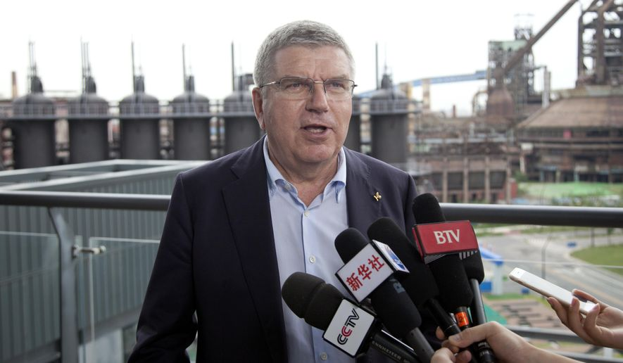"International Olympic Committee President Thomas Bach speaks during an interview at the headquarters of the Beijing 2022 Winter Olympics Organizing Committee in Beijing, Saturday, Aug. 26, 2017. Bach said Saturday he sees ""no reason for any immediate concern"" about tensions on the Korean Peninsula affecting next year's Winter Olympics in Pyeongchang, South Korea. (AP Photo/Christopher Bodeen)"