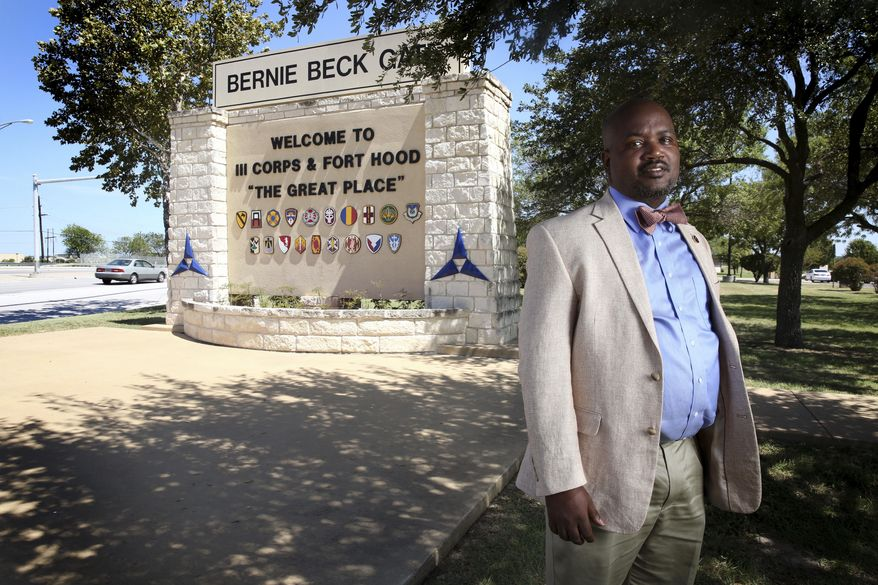 In this Aug. 22, 2017, photo, Riakos Adams, secretary of the Killeen chapter of the NAACP, poses for a photograph outside the Fort Hood military post in Fort Hood, Texas. Some, including Adams, say Fort Hood, one of the largest military bases in the world and a garrison named in honor of Confederate Gen. John Bell Hood, should be renamed. (Rose Baca/The Dallas Morning News via AP)