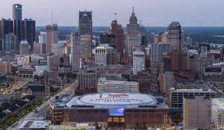 In an undated photo provided by Olympia Development of Michigan, Little Caesars Arena, foreground, stands in Detroit, north of downtown. Chris Ilitch looked and sounded like an excited tour guide for nearly two hours, giving The Associated Press an exclusive look inside Little Caesars Arena. The future home of the Detroit Red Wings and Pistons is the gem of a $1.2 billion, 55-block development dubbed The District Detroit. (Rob Kohn/Olympia Development of Michigan via AP)