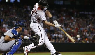 Arizona Diamondbacks' Paul Goldschmidt connects for a two-run home run against the Los Angeles Dodgers during the first inning of a baseball game Wednesday, Aug. 30, 2017, in Phoenix. (AP Photo/Ross D. Franklin)