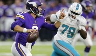 Minnesota Vikings quarterback Taylor Heinicke (6) runs from Miami Dolphins defensive end Terrence Fede, right, during the first half of an NFL preseason football game, Thursday, Aug. 31, 2017, in Minneapolis. (AP Photo/Jim Mone)