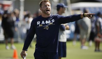 FILE - In this Saturday, July 29, 2017, file photo, Los Angeles Rams coach Sean McVay gives instructions during NFL football training camp in Irvine. McVay is one of five first-time NFL head coaches who were hired for the six openings this past offseason. (AP Photo/Jae C. Hong, File)