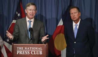 FILE - In this June 27, 2017, file photo, Colorado Gov. John Hickenlooper, left, joined by Ohio Gov. John Kasich, speaks during a news conference at the National Press Club in Washington. The bipartisan governor duo is urging Congress to retain the federal health care law's unpopular individual mandate while seeking to stabilize individual insurance markets as legislators continue work on a long-term replacement law. Kasich, and Hickenlooper shared their plan in a letter to congressional leaders Thursday, Aug. 31, 2017. (AP Photo/Carolyn Kaster, file)