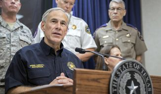 Texas Governor Greg Abbott speaks during a press briefing Wednesday, Aug. 30, 2017, at the State of Texas Emergency Command Center at Department of Public Safety headquarters in Austin, Texas as he updates the public about how the Texas government plans to help the people who are affected by the Tropical Storm Harvey.  A weaker Harvey replicated its devastating roll Wednesday, returning to shore with a deluge of rain that inundated homes and highways and left police and government officials struggling to pluck people from the water.(Ricardo B. Brazziell /Austin American-Statesman via AP)