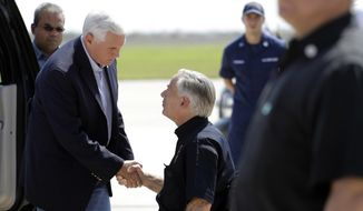 Vice President Mike Pence, left, and Texas Gov. Greg Abbott, right, talk as they prepare to visit areas affected by Hurricane Harvey, Thursday, Aug. 31, 2017, in Corpus Christi, Texas. (AP Photo/Eric Gay)