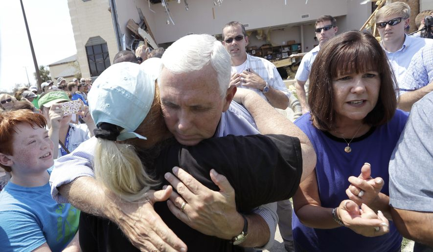 Vice President Mike Pence, center, with his wife Karen, right, shares a hug as he tries to encourage residents effected by Hurricane Harvey during a visit, Thursday, Aug. 31, 2017, in Rockport, Texas. (AP Photo/Eric Gay)