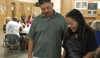 """FILE - In this Sept. 15, 2011 file photo, Tim Cordova, 41 and his wife, Sandra, 51, talk with other homeless people during a 'life recovery"""" program at Joy Junction shelter in Albuquerque, N.M. Joy Junction founder Jeremy Reynalds said late Wednesday, Aug. 30, 2017, that the city of Albuquerque has pulled out as a sponsor for his group's annual pre-Thanksgiving Dinner over criticism of Mayor Richard Berry. (AP Photo/Russell Contreras, file)"""