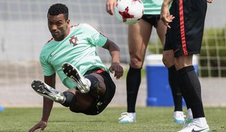 FILE -- In this July 1, 2017 file photo, Portugal's Nani attends a training session at the Spartak Stadium in Moscow, Russia.  Portugal winger Nani, who in his career has won four Premier League titles and the Champions League with Manchester United and a European Championship in 2016 with Portugal, has moved on loan from his current team Valencia to Lazio, with the right for the team to buy him on a permanent basis at the end of the season. (AP Photo/Denis Tyrin)