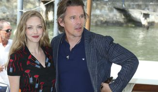 Actors Amanda Seyfried, left, and Ethan Hawke pose for photographers upon arrival for the press conference of the film 'First Reformed' during the 74th edition of the Venice Film Festival in Venice, Italy, Thursday, Aug. 31, 2017. (Photo by Joel Ryan/Invision/AP)