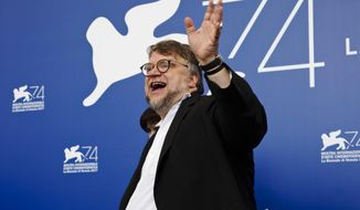 """Director Guillermo Del Toro poses for photographers during the photo call for the film """"The Shape of Water"""" at the 74th Venice Film Festival in Venice, Italy, Thursday, Aug. 31, 2017. (AP Photo/Domenico Stinellis)"""