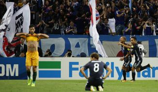 Japan's Yosuke Ideguchi is congratulated by teammate Yuto Nagatomo, right, after scoring Japan's second goal against Australia during their World Cup Group B qualifying soccer match in Saitama, Japan, Friday, Sept. 1, 2017. (AP Photo/Shuji Kajiyama)