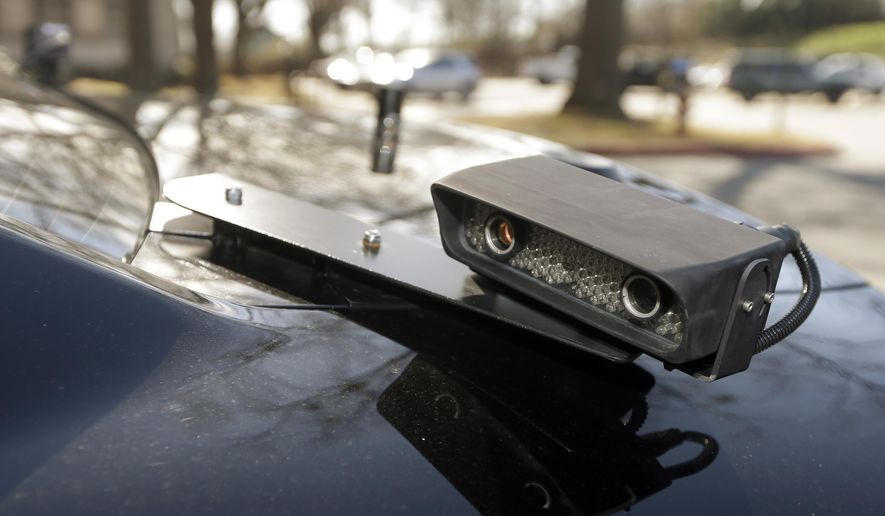 In this Jan. 16, 2013, file photo, a camera is mounted near the rear window of a police car in Little Rock, Ark. The device is part of a system that scans traffic on the streets, relaying the data it collects to a computer for sifting. (AP Photo/Danny Johnston, File) **FILE**