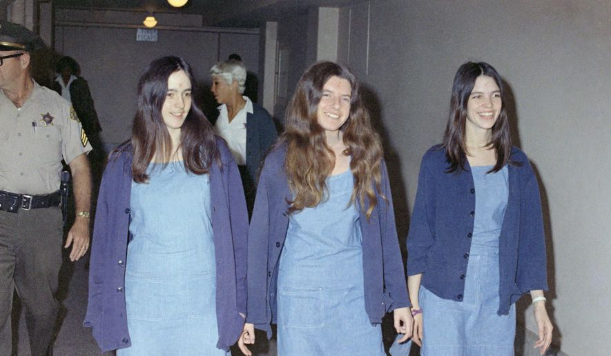 In this Aug. 20, 1970 file photo, Charles Manson followers, from left: Susan Atkins, Patricia Krenwinkel and Leslie Van Houten, walk to court to appear for their roles in the 1969 cult killings of seven people, including pregnant actress Sharon Tate, in Los Angeles, Calif. Van Houten is expected to get a court hearing Thursday, Aug. 31, 2017, to evaluate the role of her young age in the killing of a California couple four decades ago.(AP Photo/George Brich, File)