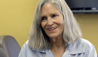 FILE - In this April 14, 2016 file photo, former Charles Manson follower Leslie Van Houten is shown during a break from her hearing before the California Board of Parole Hearings at the California Institution for Women in Chino, Calif. VanHouten is expected to get a court hearing Thursday, Aug. 31, 2017, to evaluate the role of her young age in the killing of a California couple four decades ago. (AP Photo/Nick Ut, File)