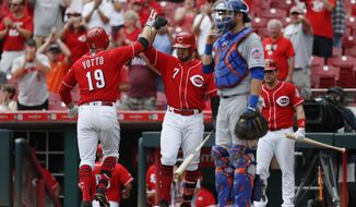 Cincinnati Reds' Joey Votto (19) celebrates with Eugenio Suarez (7) after hitting a solo home run off New York Mets relief pitcher Jeurys Familia in the seventh inning of a baseball game, Thursday, Aug. 31, 2017, in Cincinnati. The Reds won 7-2. (AP Photo/John Minchillo)