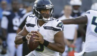 FILE - In this Aug. 13, 2017, file photo, Seattle Seahawks quarterback Russell Wilson (3) looks for a receiver during the first half of an NFL preseason football game against the Los Angeles Chargers in Carson, Calif. Wilson has had to shoulder a bigger load of the offense of late, no longer able to take a back seat to Marshawn Lynch and the running game. He threw for a career-high 4,219 yards last season. (AP Photo/Jae C. Hong)