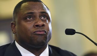 FILE - In this Dec. 2, 2014, file photo, National Football League (NFL) Executive Vice President of Football Operations Troy Vincent becomes emotional as he testifies on Capitol Hill in Washington, before the Senate Commerce Committee hearing on domestic violence in professional sports. Troy Vincent has heard, far too often, the No Fun League reference to his sport. While he finds it a totally inaccurate description, Vincent is confident the NFL will be even more entertaining in 2017.  (AP Photo/Susan Walsh, File)