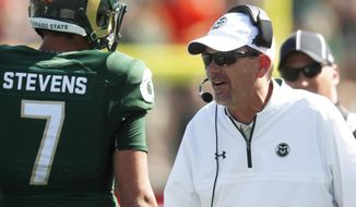 Colorado State head coach Mike Bobo, right, talks with quarterback Nick Stevens during a time out against Oregon State in the second half of an NCAA college football game Saturday, Aug. 26, 2017, in Fort Collins, Colo. (AP Photo/David Zalubowski)