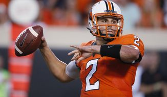 Oklahoma State quarterback Mason Rudolph (2) passes during the first half of an NCAA college football game against Tulsa in Stillwater, Okla., Thursday, Aug. 31, 2017. (AP Photo/Sue Ogrocki)