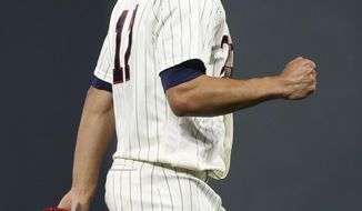 Minnesota Twins pitcher Jose Berrios pumps his fist after striking out Chicago White Sox's Adam Engel during the seventh inning of a baseball game Wednesday, Aug. 30, 2017, in Minneapolis. Berrios picked up his 12th win, in the Twins' 11-1 victory. (AP Photo/Jim Mone)