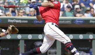 Minnesota Twins' Eddie Rosario follows through on a double during the third inning of a baseball game against the Chicago White Sox, Thursday, Aug. 31, 2017, in Minneapolis. (AP Photo/Paul Battaglia)