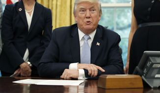 President Donald Trump speaks about Harvey in the Oval Office of the White House, Friday, Sept. 1, 2017, in Washington. (AP Photo/Alex Brandon)