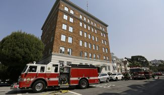Fire trucks surround the Consulate-General of Russia after black smoke was seen coming from the roof Friday, Sept. 1, 2017, in San Francisco. The U.S. on Thursday ordered Russia to shut its San Francisco consulate and close offices in Washington and New York within 48 hours in response to Russia's decision last month to cut U.S. diplomatic staff in Russia. (AP Photo/Eric Risberg) **FILE**