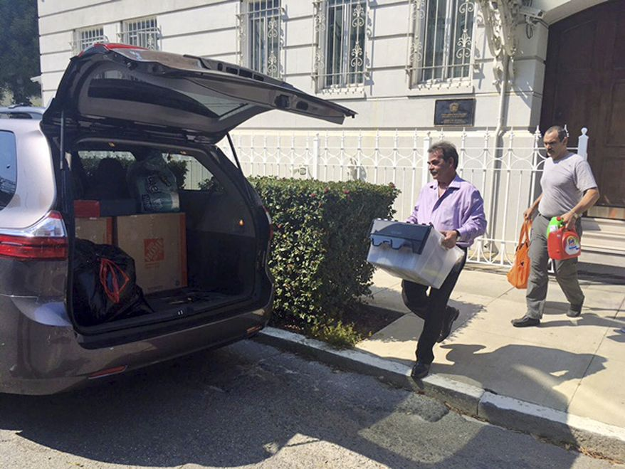 Workers carried boxes out of the Russian Consulate in San Francisco on Sept. 1, a day after the Trump administration ordered its closure amid escalating tensions between Washington and Moscow. (Associated Press)