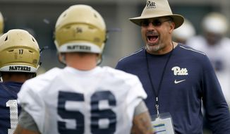 FILE - In this Aug. 11, 2017, file photo, Pittsburgh head coach Pat Narduzzi shouts during an NCAA college football practice in Pittsburgh. Pittsburgh takes on Youngstown State on Saturday, Sept. 2, 2017, in Pittsburgh. (AP Photo/Keith Srakocic, File)