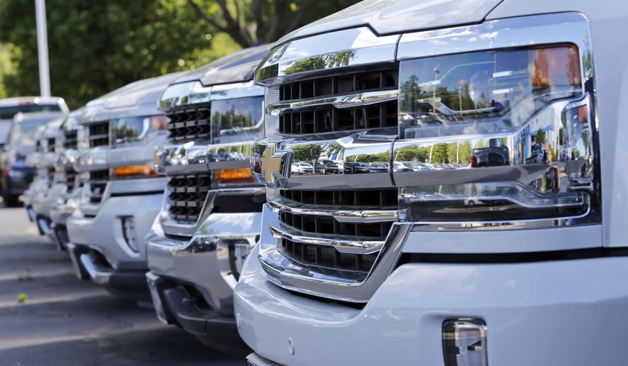 In this Wednesday, April 26, 2017, photo, Chevrolet trucks are lined up in lot at a Chevrolet dealership in Richmond, Va. On Friday, Sept. 1, 2017, automakers release vehicle sales for August. (AP Photo/Steve Helber)
