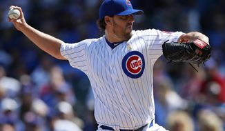 Chicago Cubs' John Lackey (41) pitches to the Atlanta Braves during the first inning of a baseball game Friday, Sept. 1, 2017, in Chicago. (AP Photo/Jim Young)
