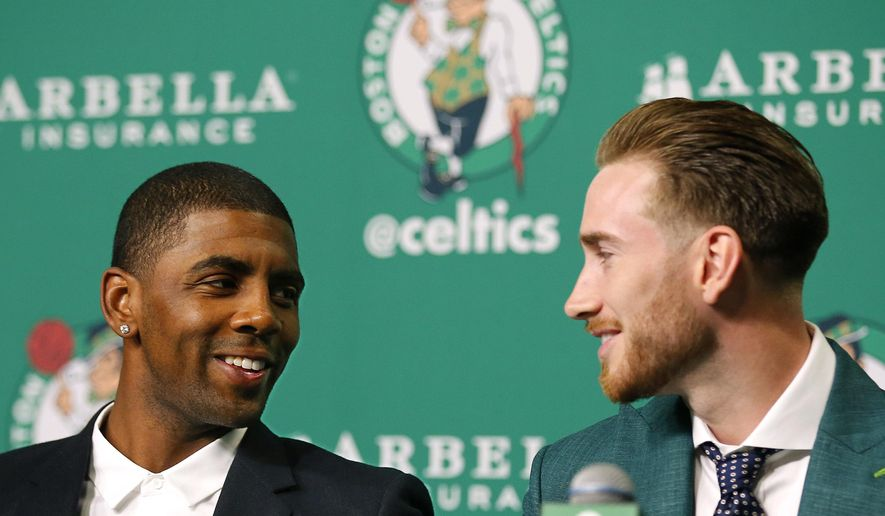 Boston Celtics' Kyrie Irving, left, and Gordon Hayward talk during a news conference in Boston, Friday, Sept. 1, 2017. (AP Photo/Winslow Townson)