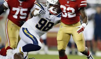 San Francisco 49ers running back Joe Williams (32) runs past Los Angeles Chargers' Isaac Rochell (98) and Ryan Carrethers (90) during the second half of a preseason NFL football game Thursday, Aug. 31, 2017, in Santa Clara, Calif. (AP Photo/D. Ross Cameron)