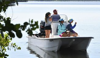 ADVANCE FOR SATURDAY SEPT. 2 AND THEREAFTER - In an Aug. 16, 2017 photo, three small boats of University of Central Florida students and biologists head out from Sebastian Inlet south side boat ramp to research turtle viruses and tumors. Half the endangered green sea turtles in the Indian River Lagoon suffer from life-threatening tumors, caused by a herpes virus that doesn't infect us, but that we make worse for turtles. Our pollution likely worsens the pathogen's impact on sea turtles, research is finding. (Tim Short/Florida Today via AP)