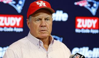 New England Patriots head coach Bill Belichick wears a University of Houston cap to show support for those affected by Tropical Storm Harvey in Houston, as he speaks to the media following an NFL preseason football game against the New York Giants, Thursday, Aug. 31, 2017, in Foxborough, Mass. (AP Photo/Winslow Townson)