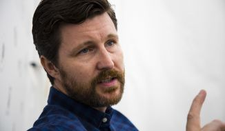 "Director Andrew Haigh speaks during an interview with The Associated Press for the film ""Lean On Pete"" at the 74th Venice Film Festival in Venice, Italy, Friday, Sept. 1, 2017. (AP Photo/Domenico Stinellis)"