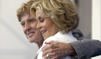 """Actor Robert Redfort, left, and Jane Fonda pose during the photo call for the film """"Our Souls At NIght"""" at the 74th Venice Film Festival in Venice, Italy, Friday, Sept. 1, 2017. (AP Photo/Domenico Stinellis)"""