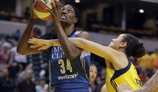 Minnesota Lynx's Sylvia Fowles is fouled by Indiana Fever's Natalie Achonwa as she goes up for a shot during the first half of a WNBA basketball game Wednesday, Aug. 30, 2017, in Indianapolis. (AP Photo/Darron Cummings)