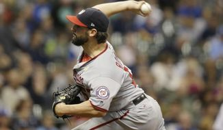 Washington Nationals starting pitcher Tanner Roark throws to a Milwaukee Brewers batter during the first inning of a baseball game Friday, Sept. 1, 2017, in Milwaukee. (AP Photo/Jeffrey Phelps)