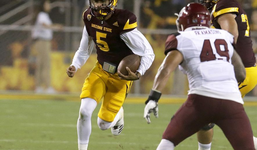 Arizona State quarterback Manny Wilkins (5) runs the ball for a first down against New Mexico State during the first half during an NCAA college football game, Thursday, Aug. 31, 2017, in Tempe, Ariz. (AP Photo/Rick Scuteri)