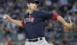 Boston Red Sox starting pitcher Doug Fister delivers the ball to the New York Yankees during the first inning of a baseball game Friday, Sept. 1, 2017, at Yankee Stadium in New York. (AP Photo/Bill Kostroun)