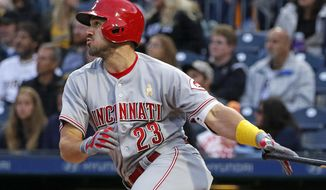Cincinnati Reds' Adam Duvall drives in two runs with a double off Pittsburgh Pirates starting pitcher Gerrit Cole during the first inning of a baseball game in Pittsburgh, Friday, Sept. 1, 2017. (AP Photo/Gene J. Puskar)