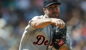Detroit Tigers starting pitcher Justin Verlander makes a pickoff throw to first base to keep Colorado Rockies' Charlie Blackmon close to the bag in the third inning of a baseball game Wednesday, Aug. 30, 2017, in Denver. The Tigers won 6-2. (AP Photo/David Zalubowski)