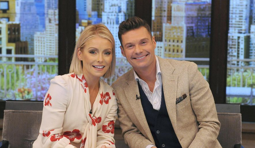 "In this Monday, May 1, 2017, file photo, released by Disney/ABC Home Entertainment and TV Distribution, Kelly Ripa and Ryan Seacrest pose for a photo at ""Live"" in New York. (Pawel Kaminski/Disney/ABC Home Entertainment and TV Distribution via AP)"
